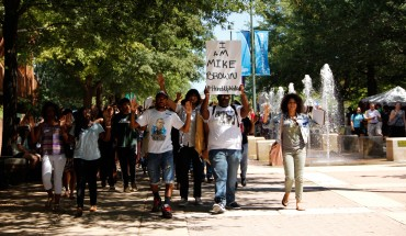 (Amy Rose/Fourth Estate) Black Student Alliance President Rasheed Parker leads students in march for solidarity for Mike Brown.