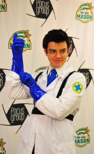 Keegan Hershell shows off his villainous poses as Blue Medic, his cosplay of choice for the evening. Photo by Claire Cecil.
