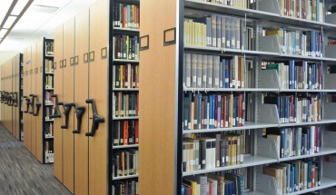 The Fenwick addition is filled with compact, movable shelving in order to hold its entire 1.5 million volume collection. (Johannah Tubalado/Fourth Estate)