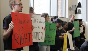 Members of GMU Student Power ask for a tuition freeze at the Board of Visitors meeting in Merten Hall on Thursday. (Amy Rose/Fourth Estate)