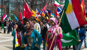 Students participate in Mason's annual International Week Parade, representing countries from all over the world. (Alya Nowilaty/Fourth Estate)