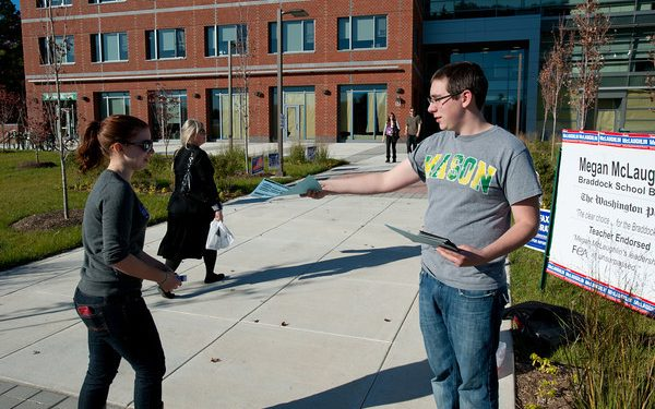 Students of Student Government & Academic Affairs encourage voting outside Mason's polling station after they successfully requested a station on Mason's Fairfax Campus.