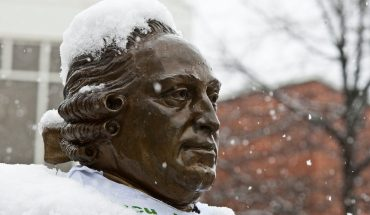 George Mason staute in snow. Photo by Craig Bisacre/Creative Serivces/George Mason University