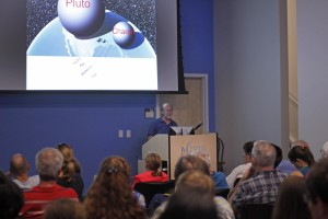 """Dr. Michael Summers speaks about Pluto at the """"Mission to Pluto"""" presentation. Photos by Claire Cecil"""