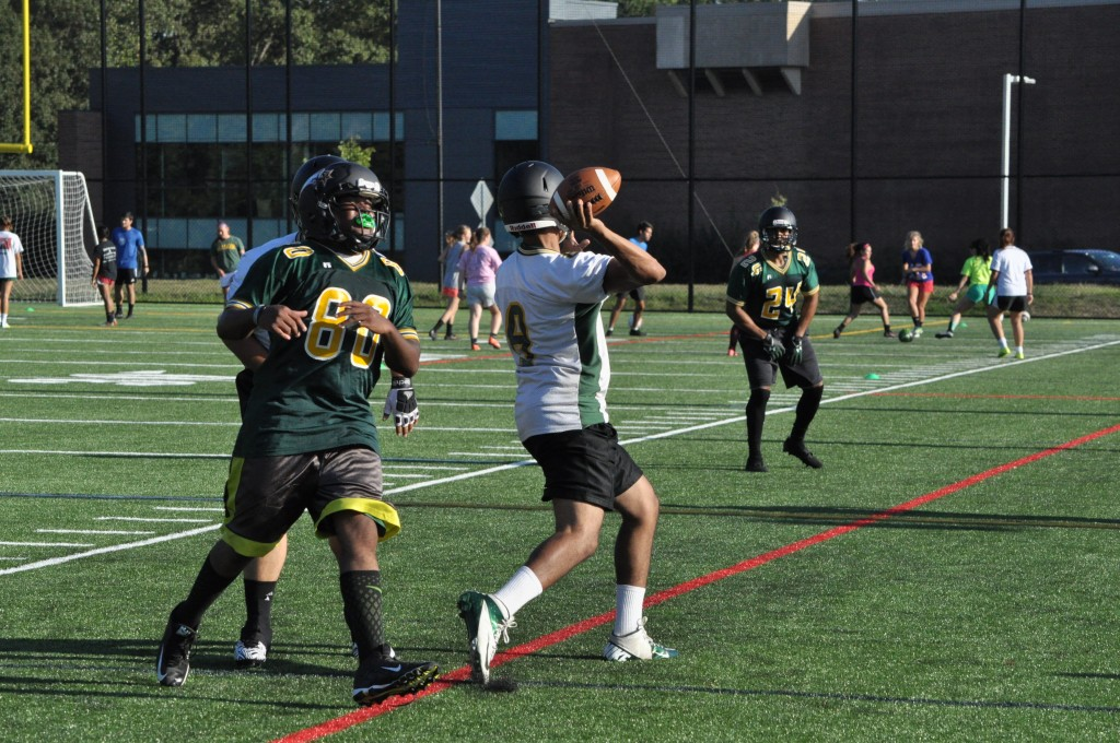 Quarterback Shareef Abulhawa makes a pass during practice on September 13. Credit: Dave Schrack, Fourth Estate