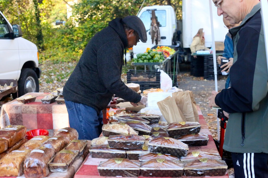 In addition to fresh fruit and vegetables, vendors offer bread and baked goods.  PC Naomi Folta